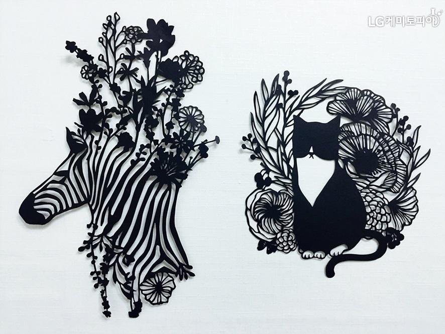 화려한 모양의 얼룩말과 고양이 페이퍼커팅아트