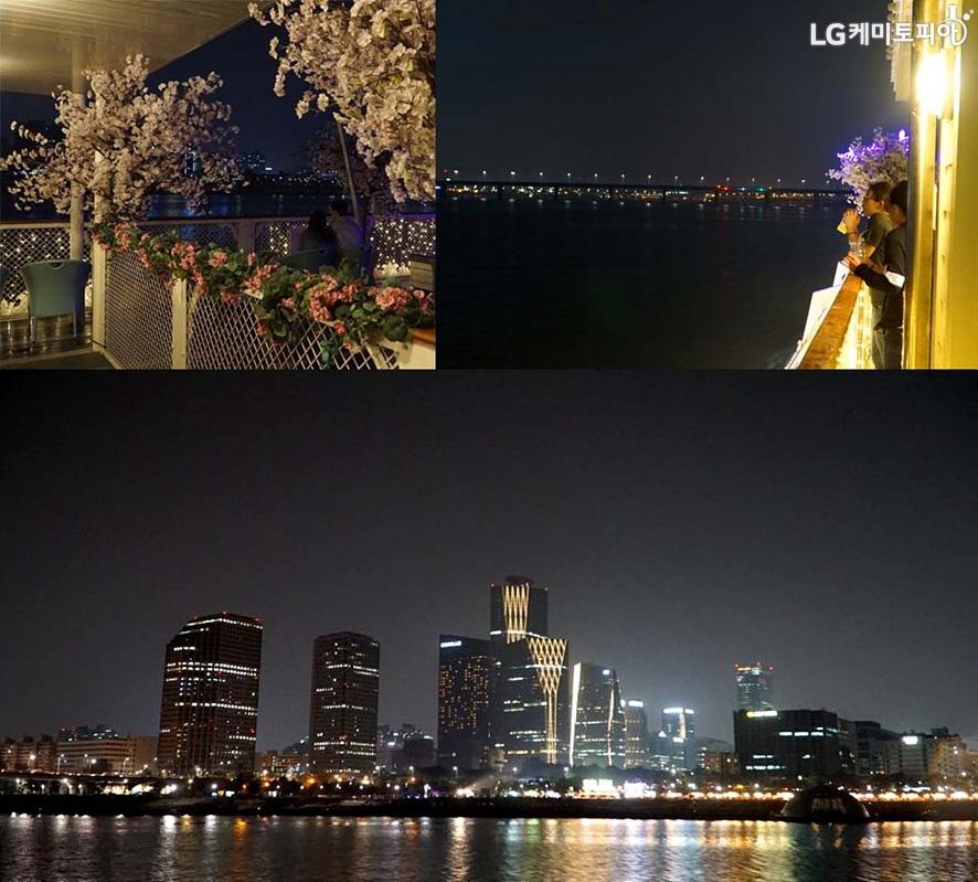 선상에서 보는 밤의 한강 야경 모습. 불켜진 고층 빌딩들이 보이고 불빛으로 반짝이는 한강이 보인다.
