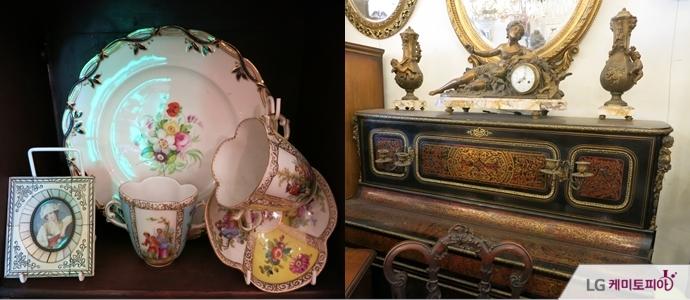 촛대 받침 장식이 달린 피아노 가구와 드레스덴 도자기가 있는 엔틱가구점