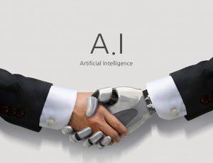사람의 손과 로봇(A.I: Artificial Intelligence)의 손이 악수를 하고 있다.